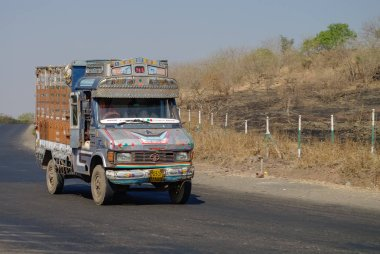 Colorful trucks brand TATA in Indian highway.