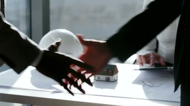 close up Two business partner shake hands when meeting in front of large panoramic window. In slow motion
