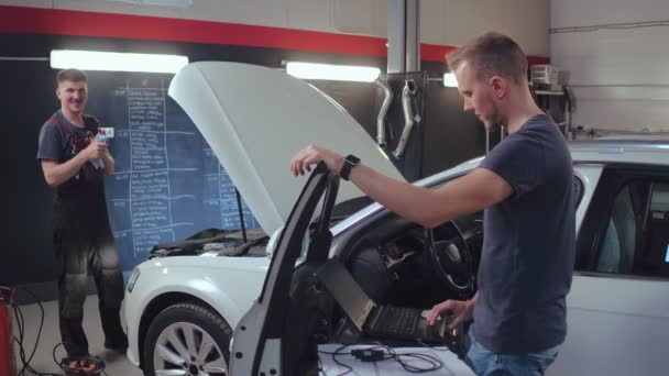 Mechanic man working in repair garage. Car diagnostic in auto service