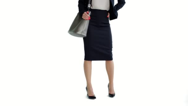 Woman in black business suit and high heel shoes standing on isolated white