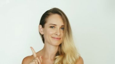Adult woman showing gesture finger moving side to side for expressing no