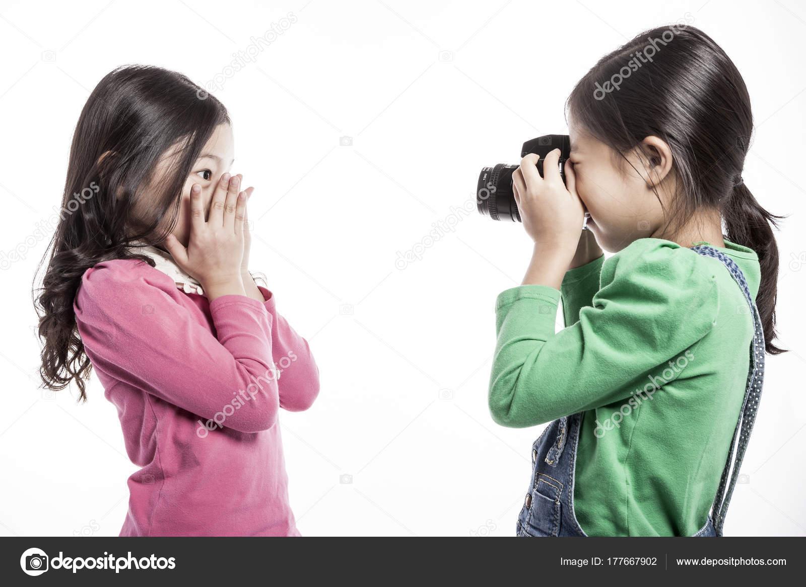 Two asian girls singing
