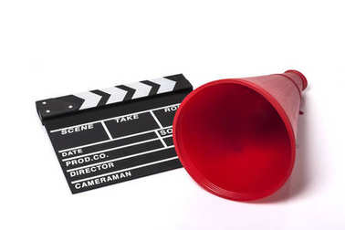 red megaphone with movie clapper isolated on the white background.
