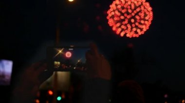 Shoot a beautiful holiday firework on the phone. Slow motion. 1920x1080.