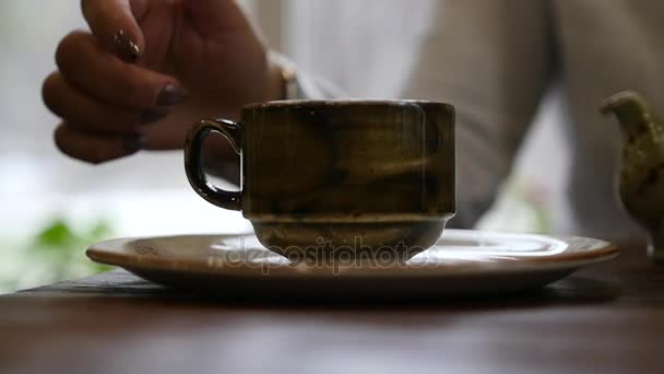 To take in hands a beautiful mug with a tasty drink, tea or coffee. slow motion, 1920x1080, full hd