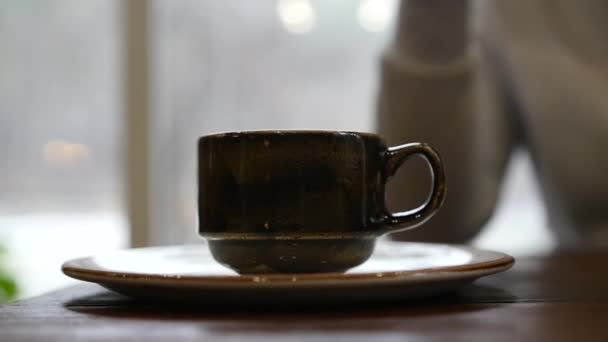 Take a cup of tea with hot tea or coffee, roll it on a cup and pick it up. slow motion, 1920x1080, full hd