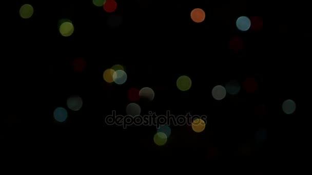 Luces De Colores Borrosas Intermitente Sobre Fondo Negro