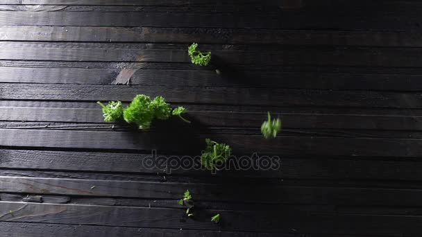 Chopped parsley falls fto the wooden board, fresh greens, vegetables and vitamins, healthy food