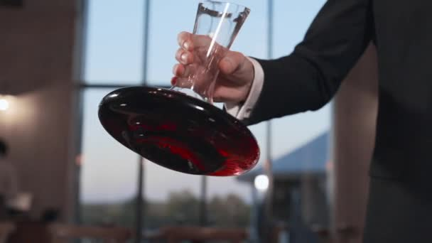 Barman shakes the wine in a decanter in slow motion, 240 frames per second, alcohol drinks, wine in restaurant