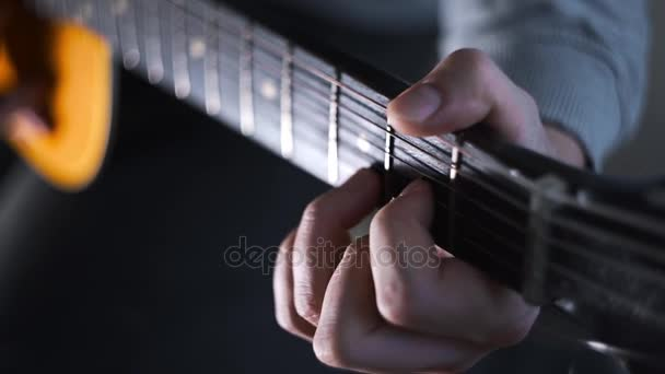 Guitar player plays random chords on the acoustic western guitar ...