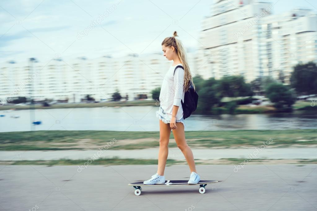 84a77adcead Beautiful young woman seating on skate and make self photo