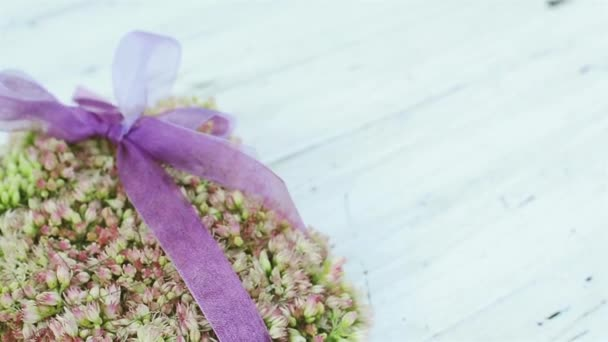 Boutonnieres of Cute Flowers on Vintage White Table.Beautiful Wedding Background