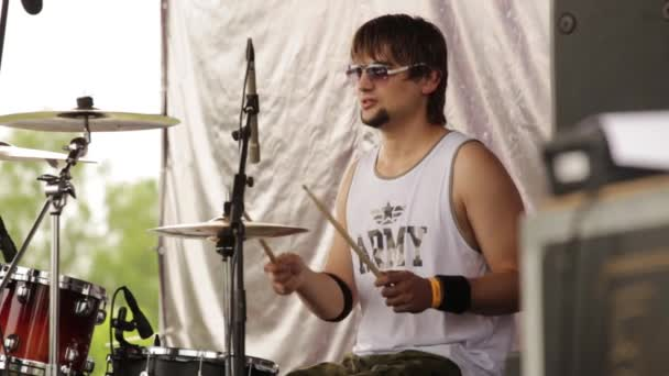 Drummer plays music while rehearsing a song in a oncert rock band
