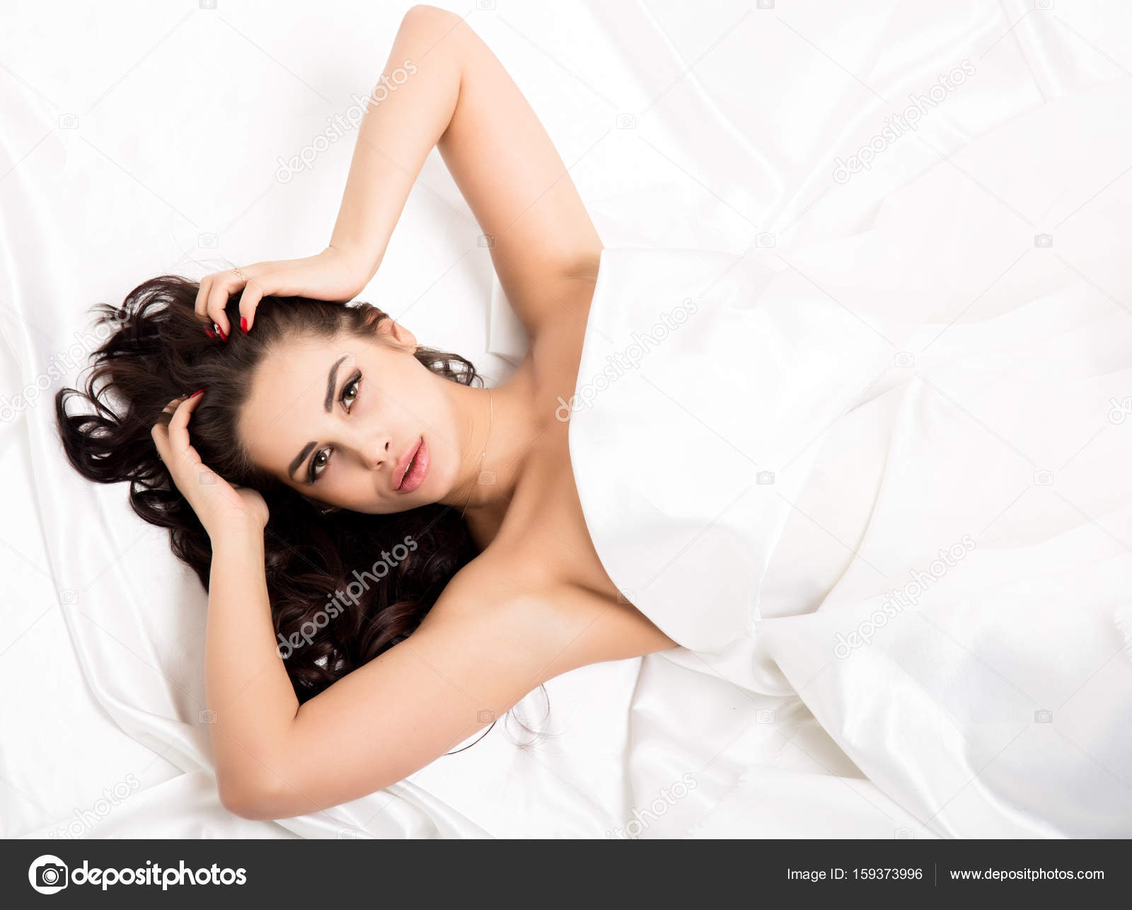 Nude white woman on bed