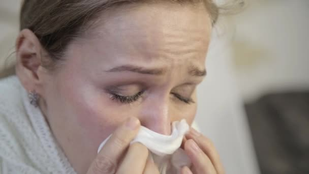 disappointment woman with brown eyes crying, wipes away tears with a paper handkerchief