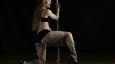 Female Erotic Dancer Dances By The Pole