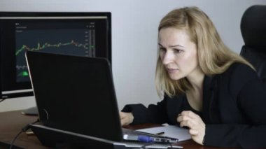 Work on a stock exchange. Businesswoman watching changes in the currency exchange chart