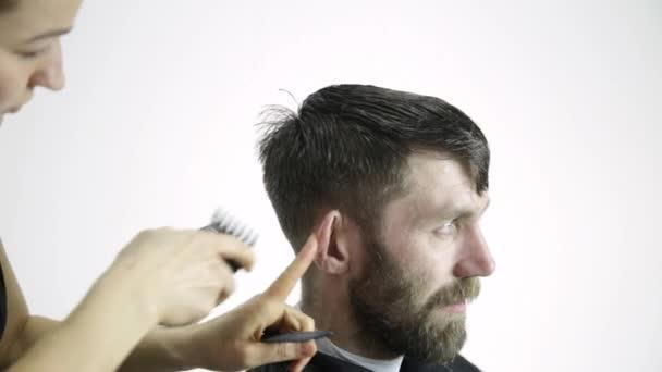 Mens haircut at barbershop. Female hairdresser shaping mens hair