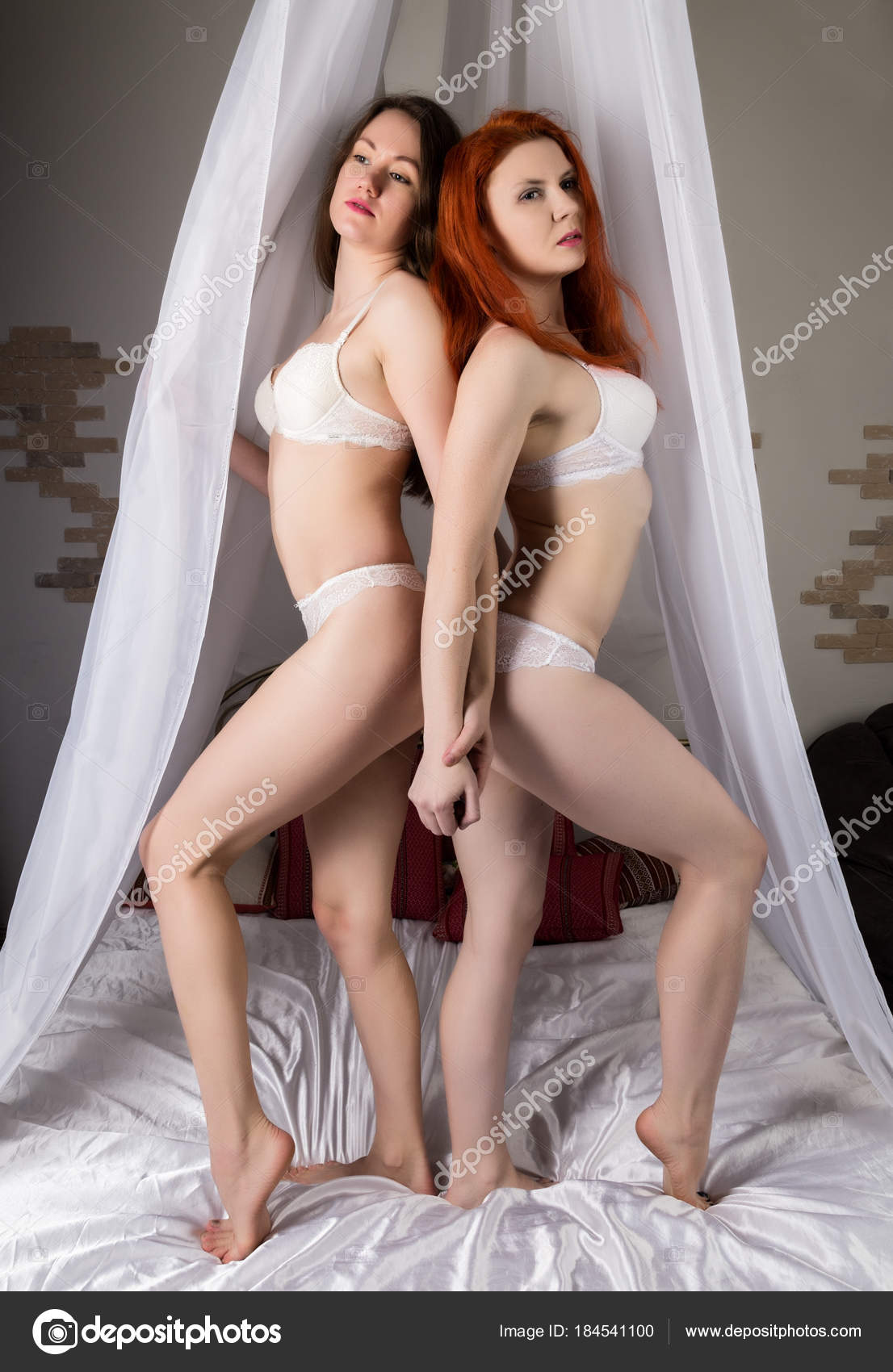 Redhead lesbians in sexy lingerie
