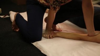 Professional therapist giving traditional Thai massage or Thai yoga massage treatment