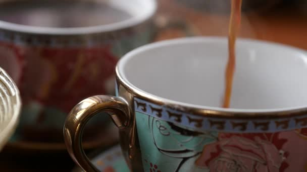 close-up pouring coffee into a cup. slow motion