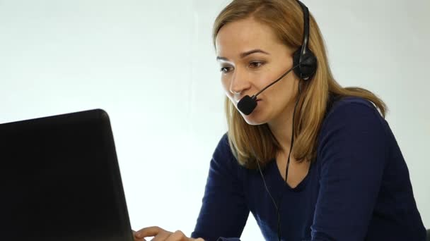 employee working in a call center. Headset telemarketing woman talking on helpline. slow motion
