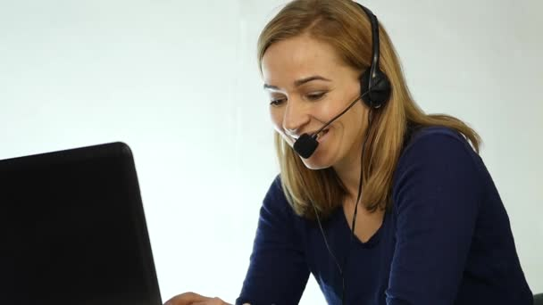 call center representative talking on helpline, Headset telemarketing positive female call center agent at work. slow motion