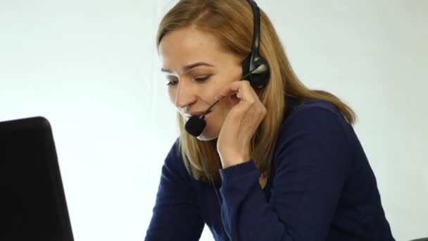 call center representative talking on helpline, Headset telemarketing positive female call center agent at work. 4K