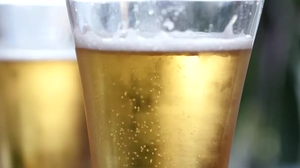 Cold light beer in a glass with water drops. beer bubbles, slow motion