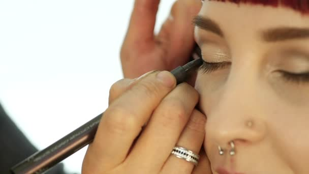 Close-up of professional make-up artist doing everyday makeup, puts powder on womans cheeks with brush