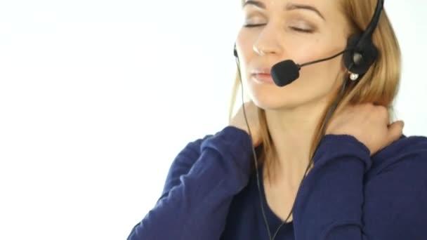 tired call center representative talking on helpline, Headset telemarketing female call center agent at work. 4K
