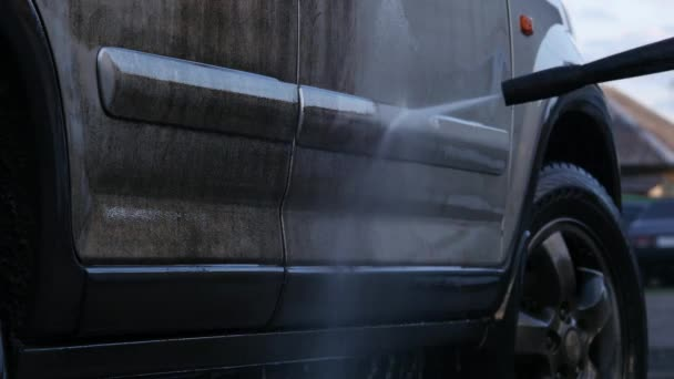 Manual car wash with pressurized water outside. very dirty car. 4K