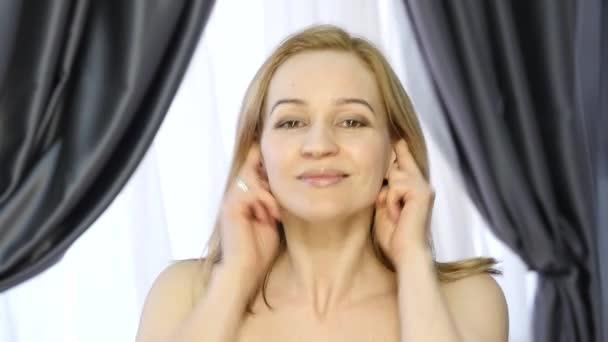 beautiful girl performs anti-aging exercises. face fitness for anti sagging skin