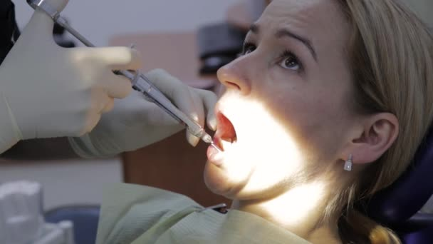 female dentist treats teeth to female patient. dentist gives anesthetic injection. Female professional doctor stomatologist at work