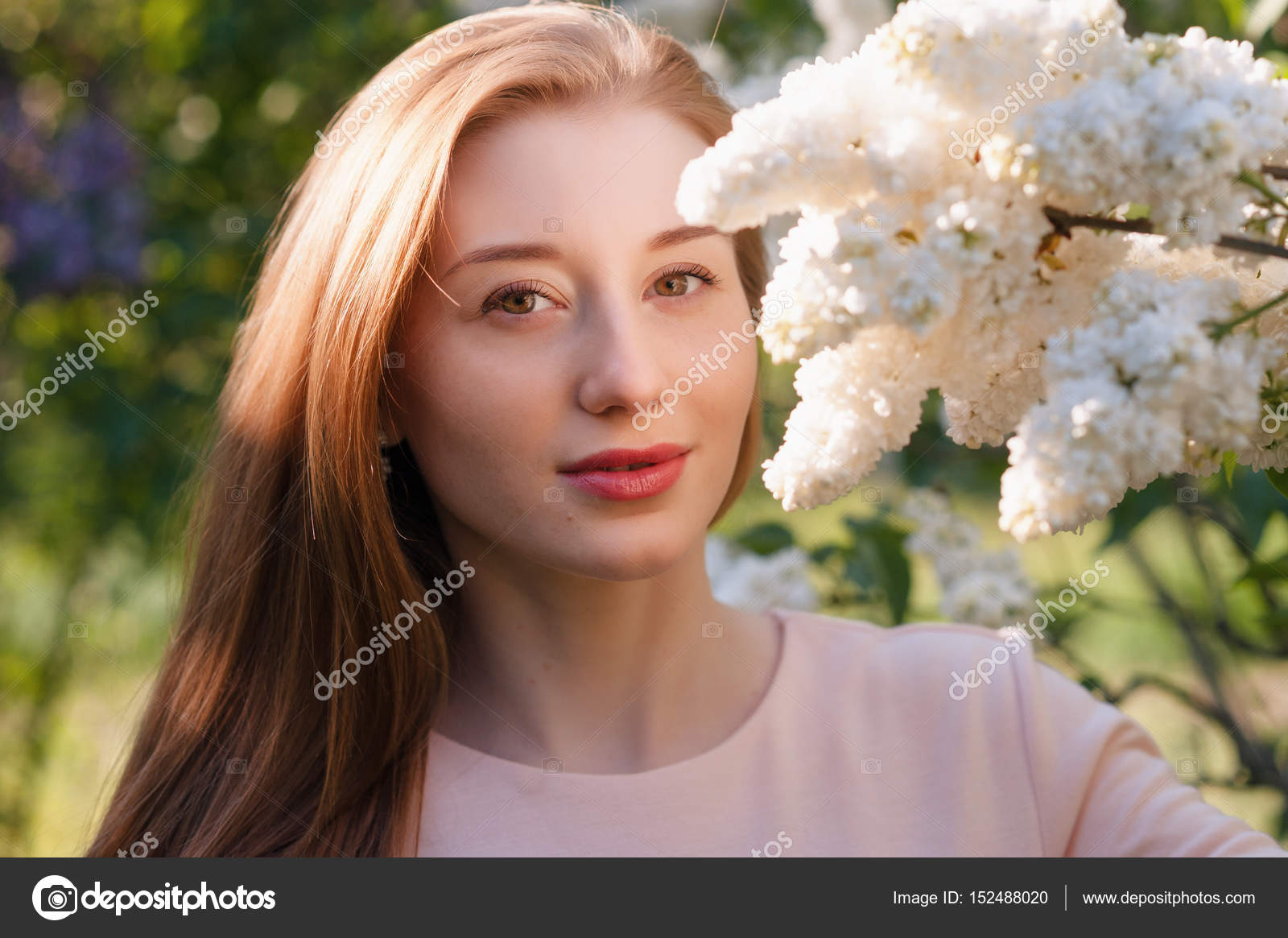 Beautiful woman with flowers of lilac skincare stock photo beautiful woman with flowers of lilac skincare stock photo izmirmasajfo Image collections