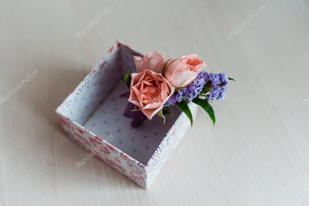 Grooms boutonniere of phlox and roses