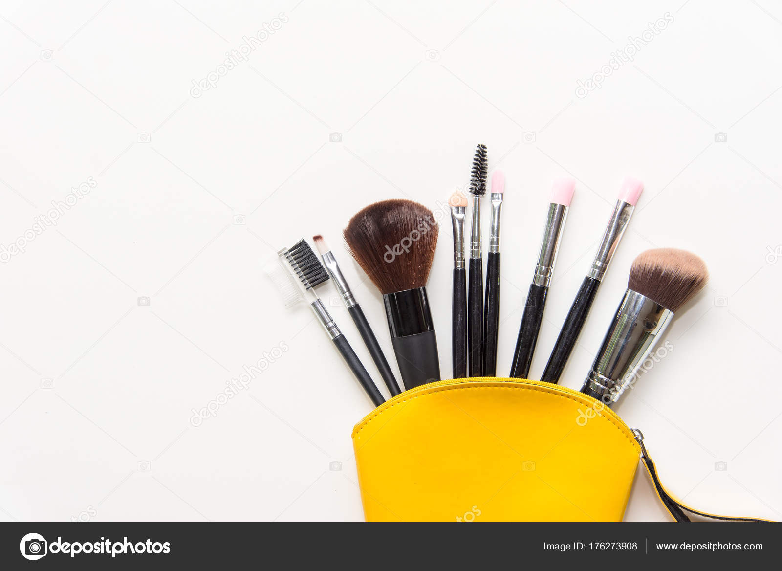 Makeup cosmetics tools background and beauty cosmetics, products and facial cosmetics package lipstick, eyeshadow in yellow bag on the white background.