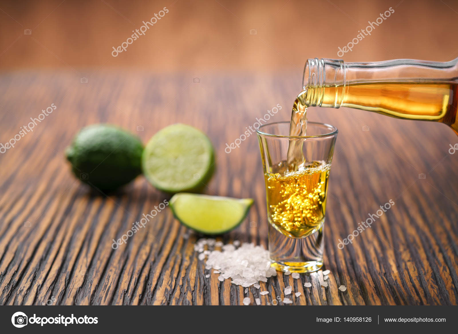 Pouring gold tequila shot with lime — Stock Photo © itor115.gmail ...