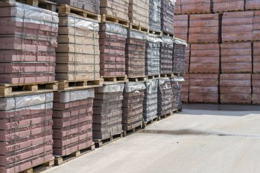 pallets with bricks in the building store. Racks with brick. Masonry, stonework.