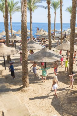 Sharm El Sheikh, Egypt - November 21, 2019: Tourists and animators dancing on the beach. Animators entertaining visitors at the music.