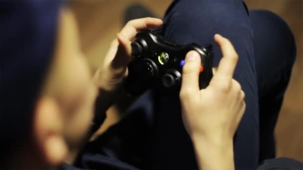 Boy playing game console joystick