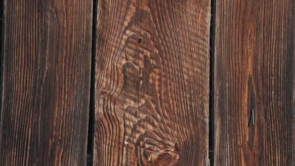 Schwenk-Aufnahme der braunen Holzzaun-Textur für Hintergrund-Makro-Front