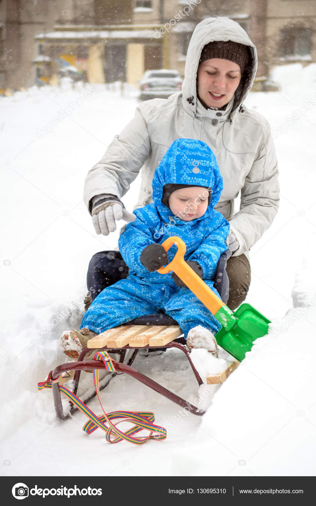 Christmas Vacation Sled.Young Mother And Little Boy Enjoying Sleigh Ride Child