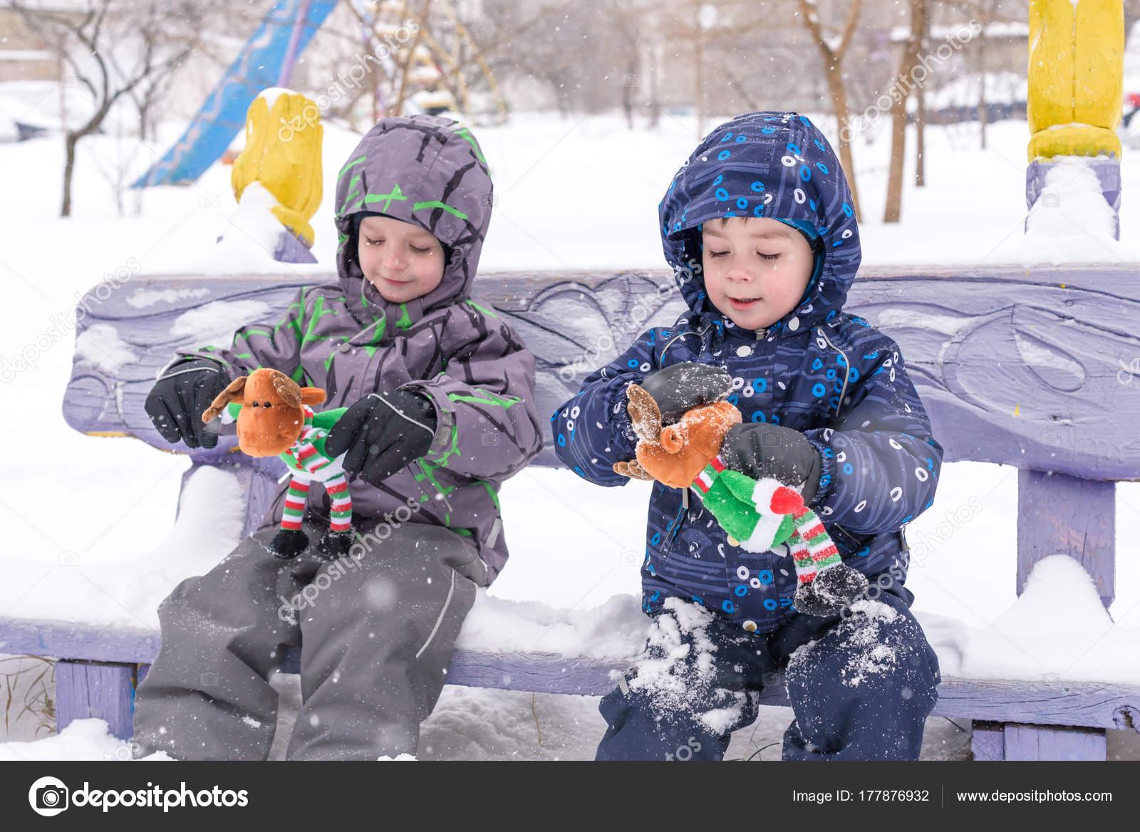 2ad7d2a5deea two adorable preschool kids brother boys in winter wear sit amou ...
