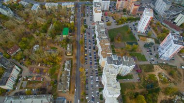 Typical city of Russia at sunset in center. Aerial view