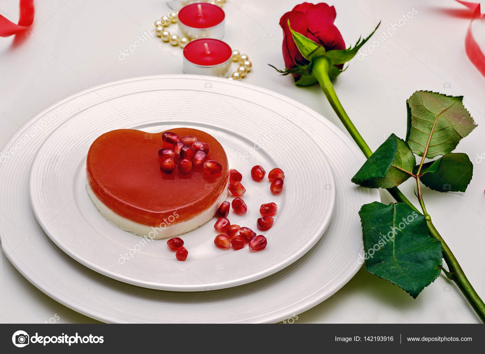 Heart shaped red cake on a white plate. Delicious dessert for Valentines Day Romantic dinner & Heart shaped red cake on a white plate. Delicious dessert for ...
