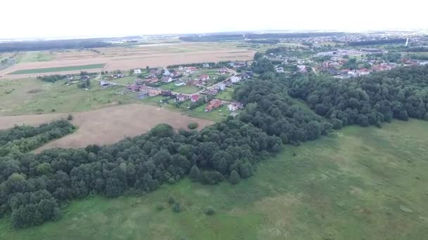 Flight Over Meadow Near Forest And Town In Distance