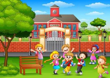 Happy school children playing in front of school building