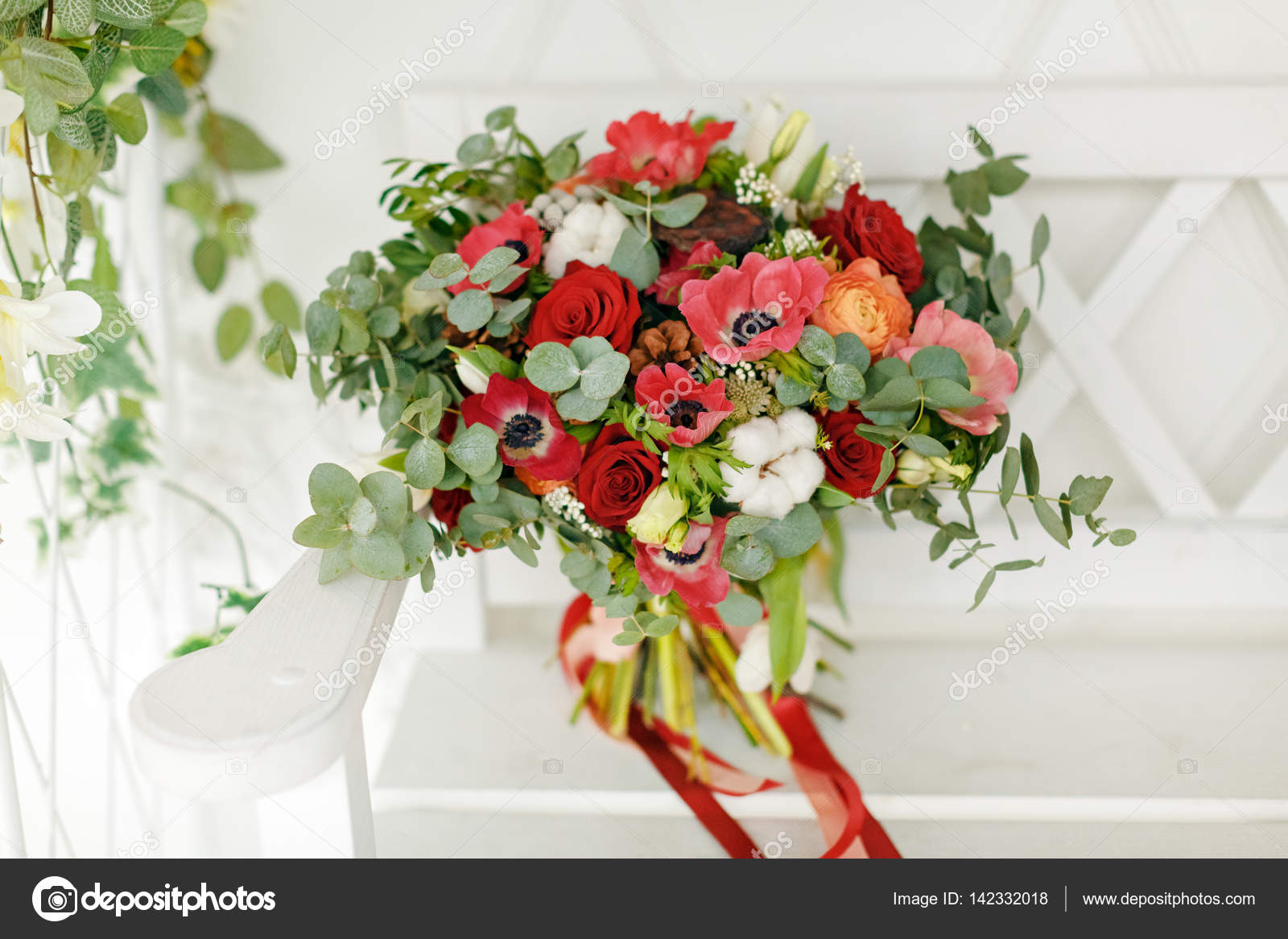 Beautiful bright bouquet of flowers with ribbons on a light ...