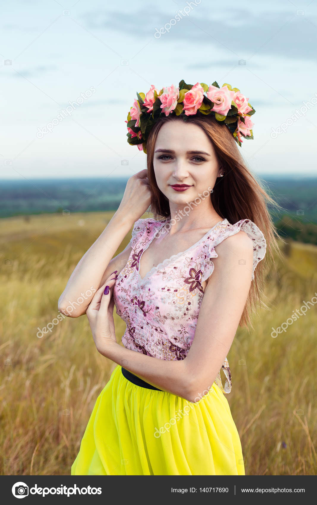 beautiful fashionable pretty gorgeous girl in dress on the flowers
